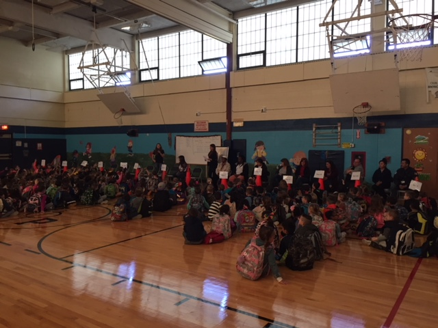Photo of Wood Park Students in gym for Peaceful Bus assembly