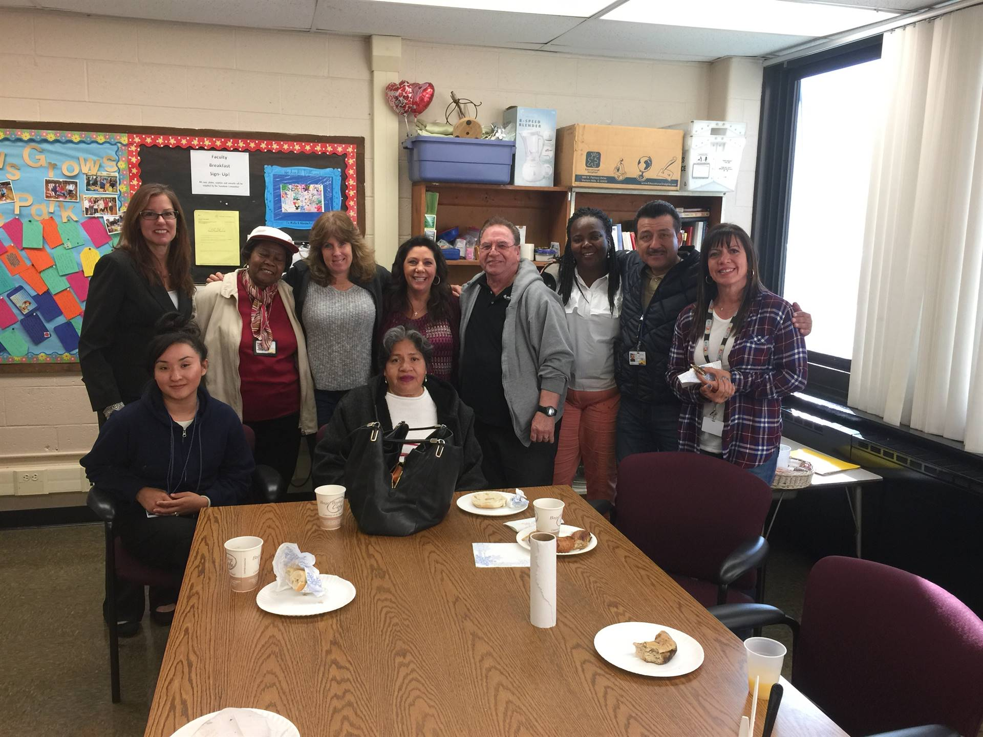 Photo of Principal, Mrs. Collison sharing an Appreciation Breakfast with the Wood Park Bus Drivers a