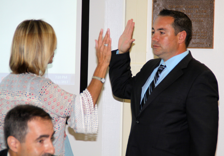 Mr. Hender was sworn in as a new BOE trustee.