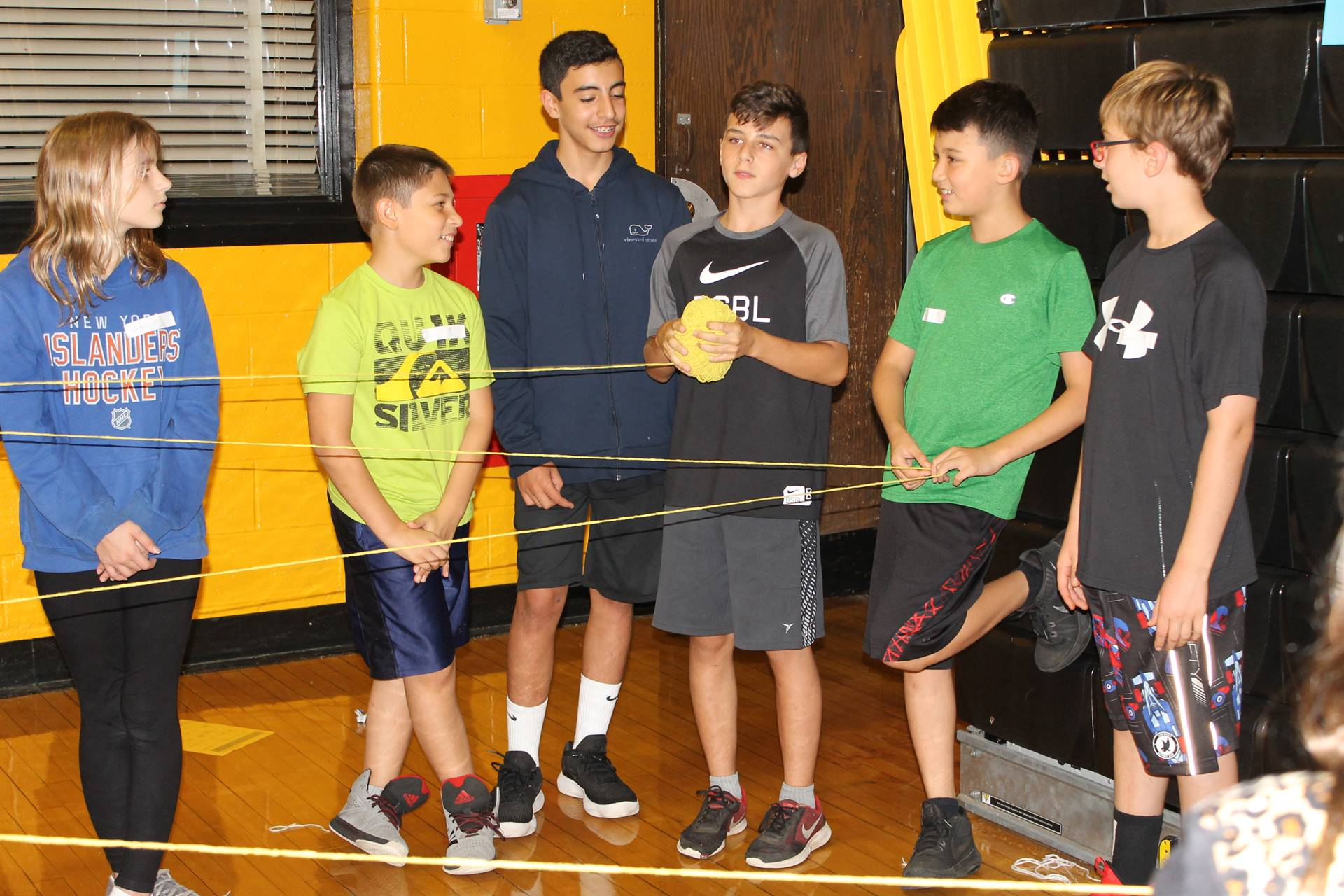 students tossing yarn during a building relationships game
