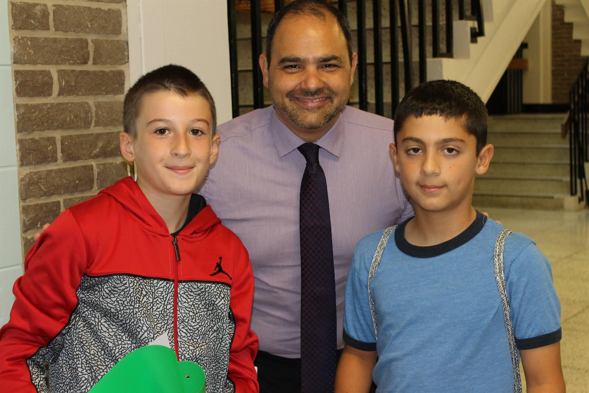 Principal, Mr. Davidson, with 2 students