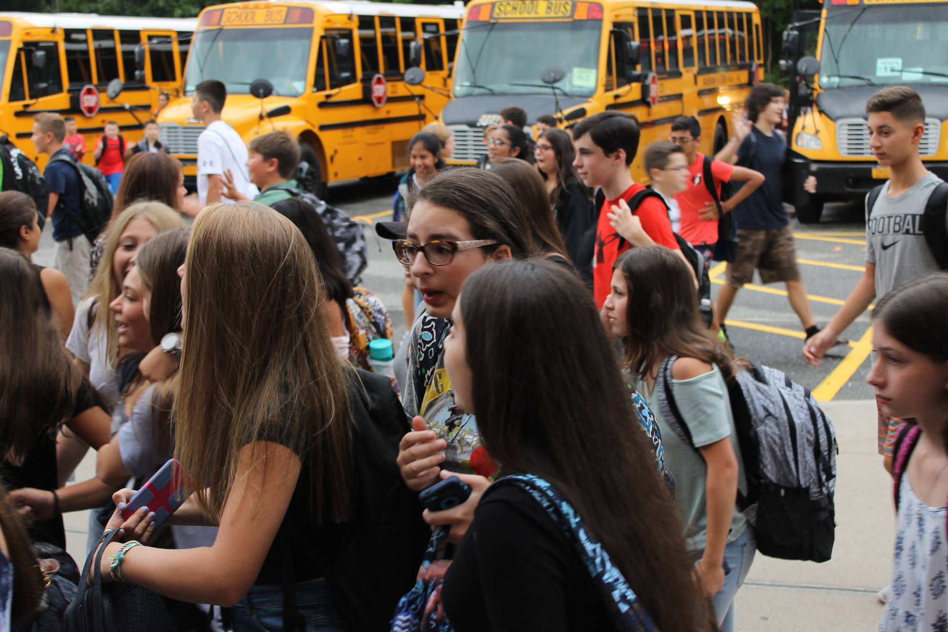 Students getting off school buses