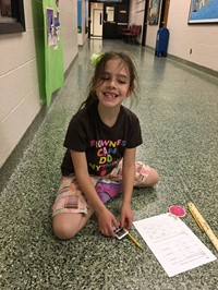 Student In Hallway Measuring Distance With Ruler