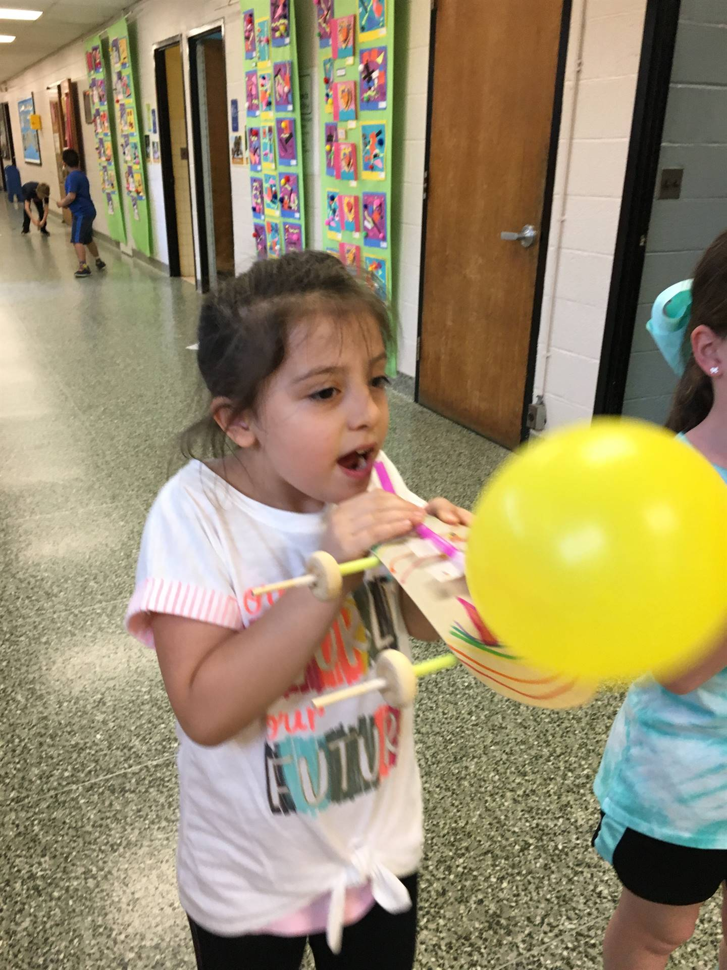Student Blowing Up Balloon For Balloon Car