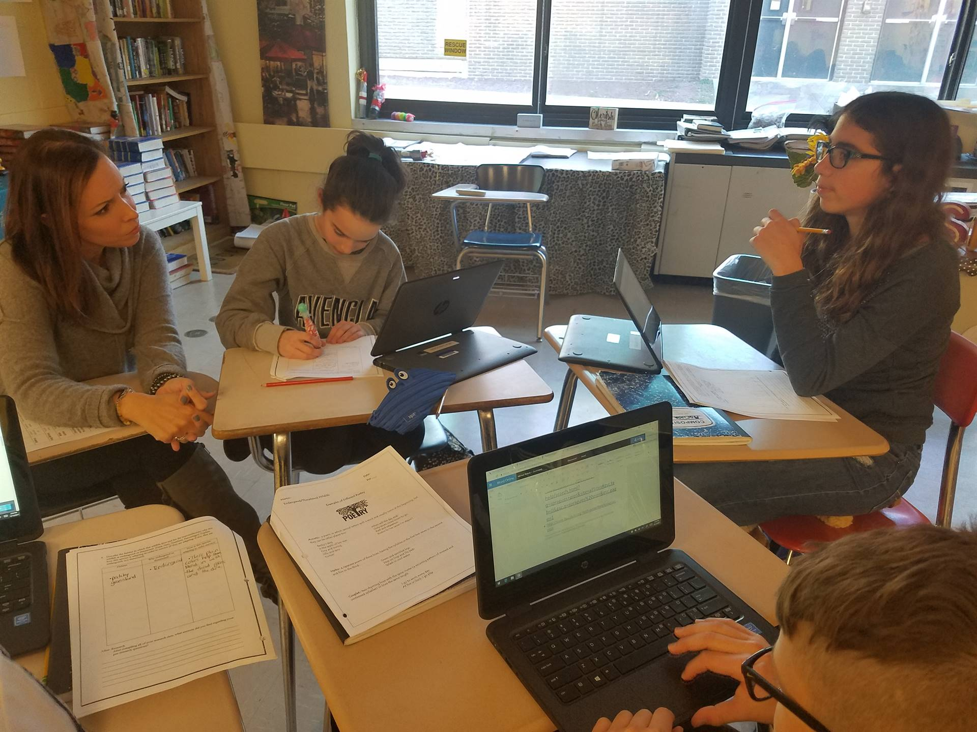 Students working in Language and Literature classes on a book.