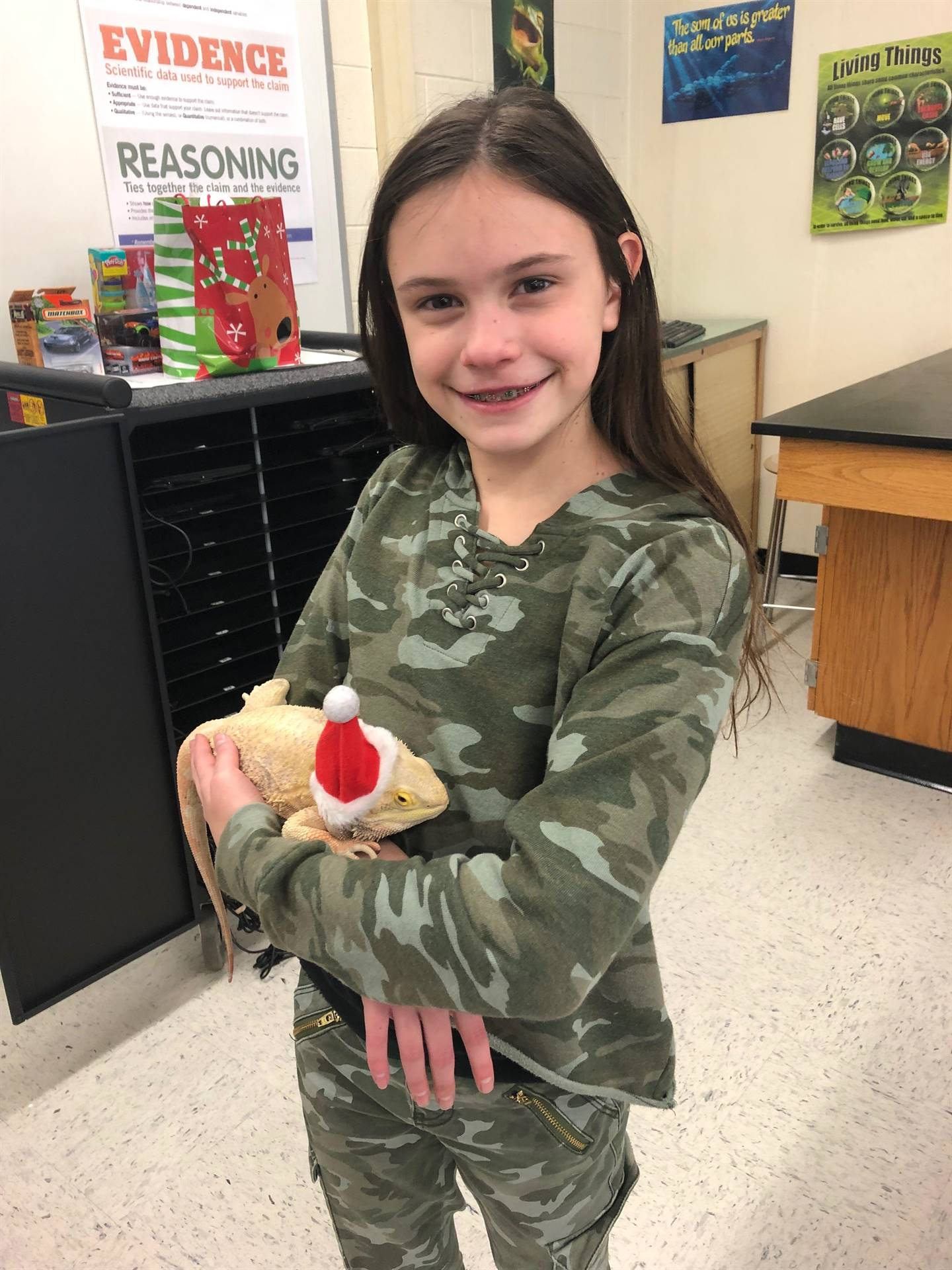 student holding bearded dragon