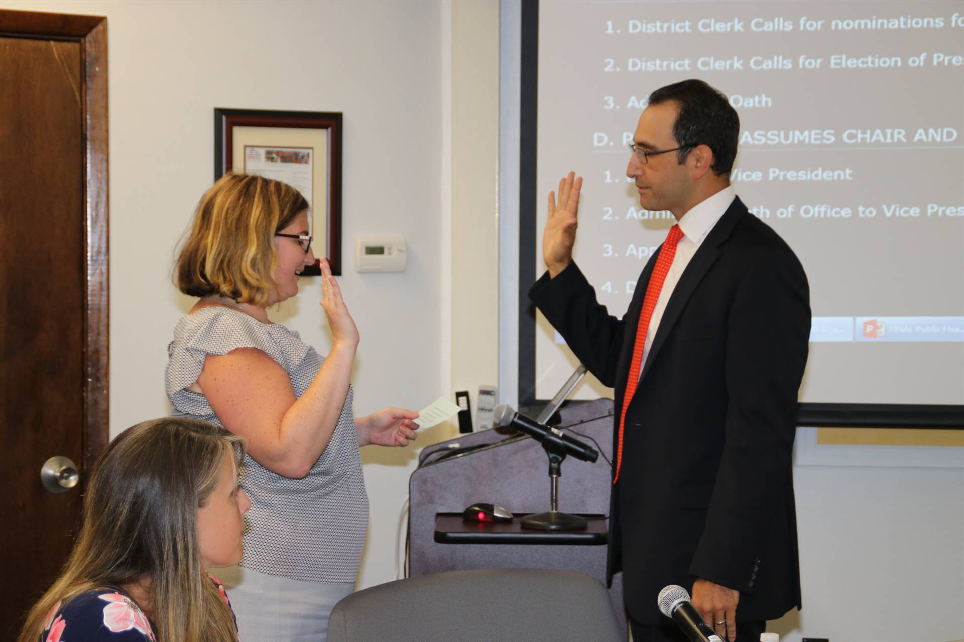 Board of Education Member Jarrett Behar is sworn in as a new BOE member
